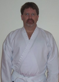 Over 40 White Belt Pete Rindal in his brand new uniform